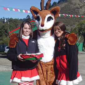 Rudolph with elves at Santa's Tree Farm